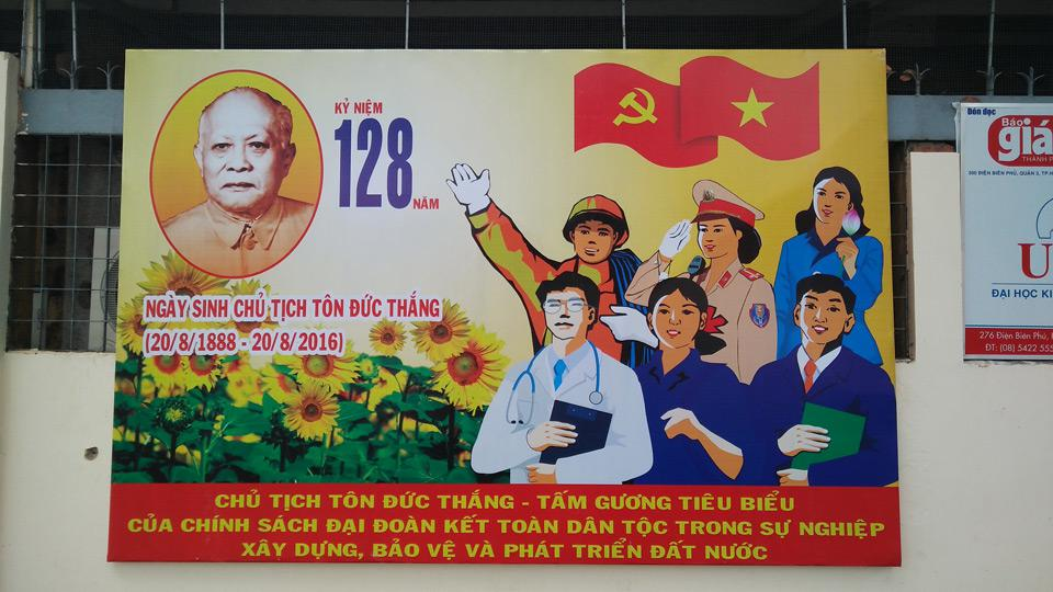 Communist poster in the street of Saigon